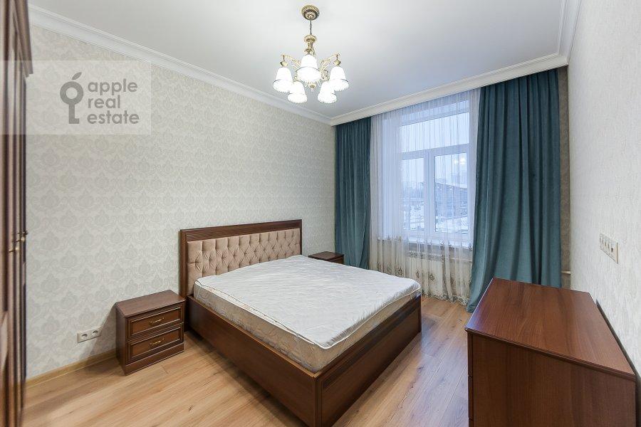 Bedroom of the 3-room apartment at ulitsa Dobrolyubova 29/16